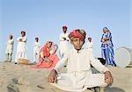 Group of performers in a desert, Thar Desert, Jaisalmer, Rajasthan, India