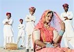 Performers posing in a desert, Thar Desert, Jaisalmer, Rajasthan, India