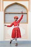 Teenage boy dancing in a palace, City Palace, Jaipur, Rajasthan, India