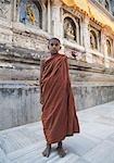 Monk standing in a temple, Mahabodhi Temple, Bodhgaya, Gaya, Bihar, India