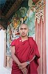 Monk standing in a temple, Bhutan Temple, Bodhgaya, Gaya, Bihar, India