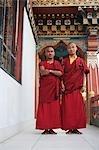 Two monks standing in the temple, Bhutan Temple, Bodhgaya, Gaya, Bihar, India