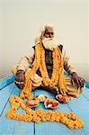 Sadhu sitting in a boat and praying, Ganges River, Varanasi, Uttar Pradesh, India