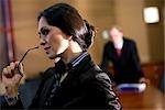 Portrait of contemplative mid adult businesswoman standing in boardroom