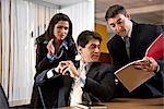Hispanic businesspeople talking in office