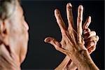 Close-up of senior man's hands, studio shot