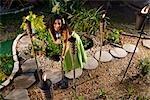 Young Hispanic woman singing on tropical island