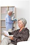 Senior couple reading at home
