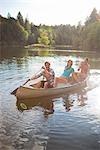 Teenagers Canoeing on Lake Near Portland, Oregon, USA