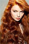 Close-up of wavy redhead woman