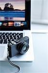 Still Life of Digital Camera on a Laptop Computer