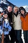 A family on a snowy mountain