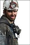Mine worker with flashlight helmet