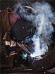 USA, Utah, Orem, man welding metal