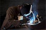 USA, Utah, Orem, man welding metal in workshop