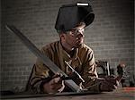 USA, Utah, Orem, male welder in workshop