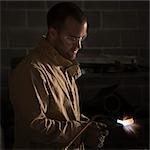 USA, Utah, Orem, male welder using blowtorch in workshop
