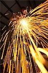USA, Utah, Orem, sparks from man welding metal