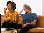 USA, Utah, Provo, couple sitting on sofa