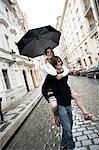 Couple with umbrella in the rain