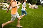 Three girl friends running outside
