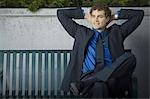 Businessman sitting on a bench