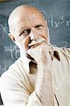 Closeup of male school teacher holding chalk