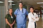 Doctors and nurse posing