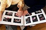 Mature hands on photo album