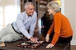 Mature couple playing backgammon