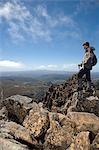 A hiker on the summit of Cradle Mountain,Tasmania