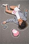 Woman on Ground with Chalk Line around Body