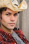 Close-up Portrait of Man wearing Cowboy Hat