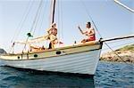 A senior couple sailing