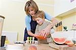boy and mum making fruit lollies