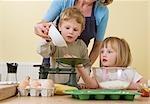 boy, girl and mum making buns