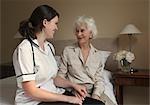 Nurse holding the hand of elderly woman