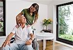 woman touching man in wheelchair
