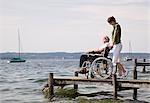 woman and senior man in wheelchair