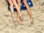 Girls lying at the beach