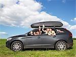girls waving out of car windows