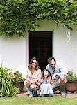Family outside countryside house
