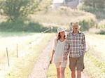 Man and woman walking down lane