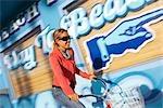Woman Riding a Cruiser Bike Along the Boardwalk in Santa Cruz, California, USA