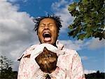 woman sneezing outside