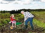 Grandfather shoveling dirt