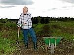 Mature man with shovel