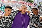 Teenage gang against graffiti wall