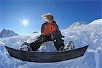 Snowboarder Sitting in Snow, Zugspitze, Bavaria, Germany