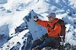 Mountain climber taking a picture on mountain peak